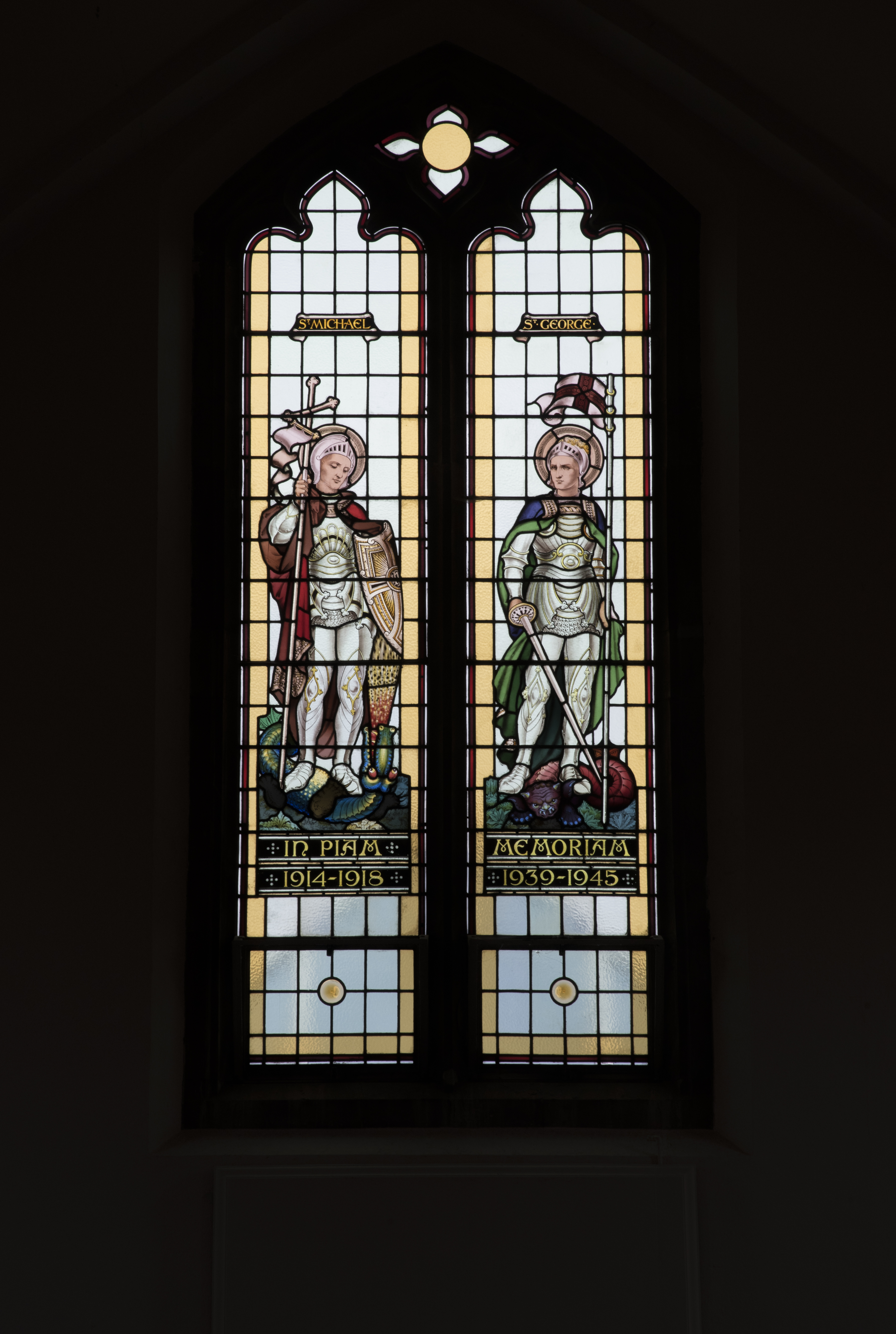 This stained glass window shows portraits of St George and St Michael, and was painted in commemoration of the lives lost in the First and Second World Wars